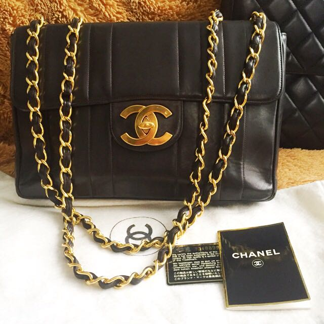 5909247ec4f0 Authentic Vintage CHANEL Jumbo XL Flap Vertical Quilted Black Lambskin,  Luxury, Bags & Wallets on Carousell