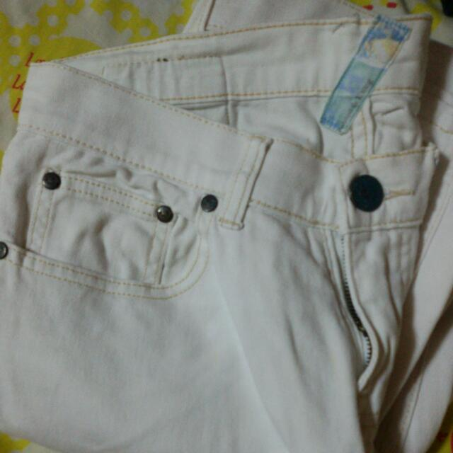 FOLDED & HUNG Tattered White Jeans