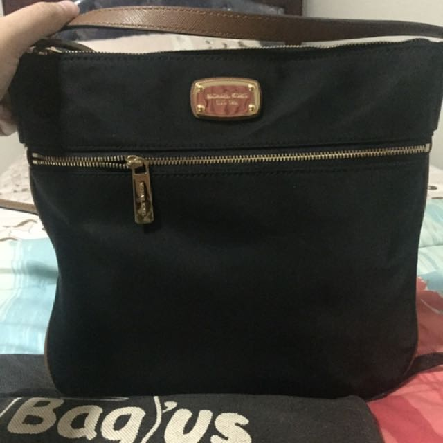 REPRICE!! Preloved Authentic Michael Kors Traveling Sling Bag