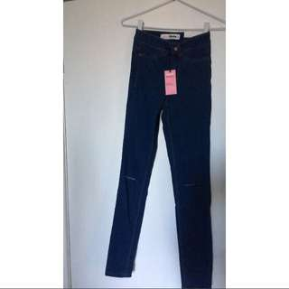 Super Ultra Skinny Ripped Mid Rise Jeans