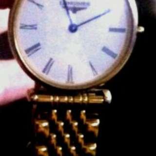 Woman's Longines Gold Watch