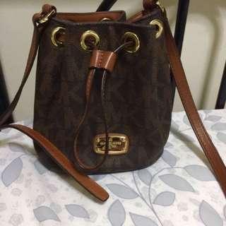 Authentic Michael kors Jules PVC Signature Brown Drawstring Crossbody bag