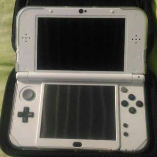 New Nintendo 3DS XL plus games and box
