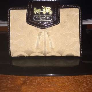 Brown and beige Coach leather purse