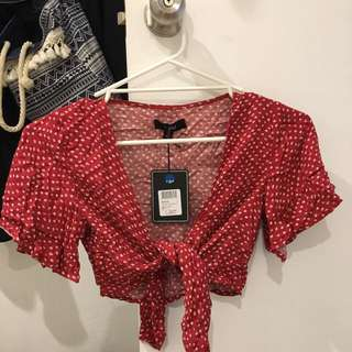 red tie up cropped tee- brand is 'Nunui' size 6