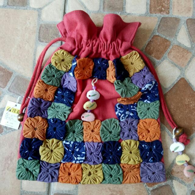 Cloth doily drawstring pouch