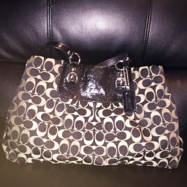 Women's black and white Coach bag