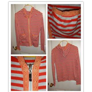 pretty orange stripes cardigan, size S   with hood & pockets, zipped   bought overseas, you won't find another one in NZ   good condition from a clean, tidy & non-smoking family