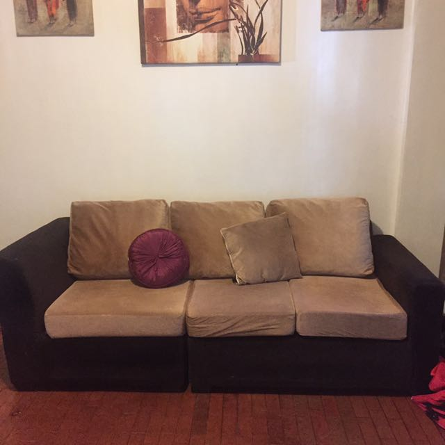 Cream And Chocolate Colored Sofa