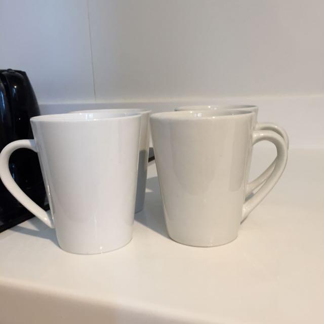 Four White Coffee Mugs