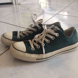 Dark green low-cut converse