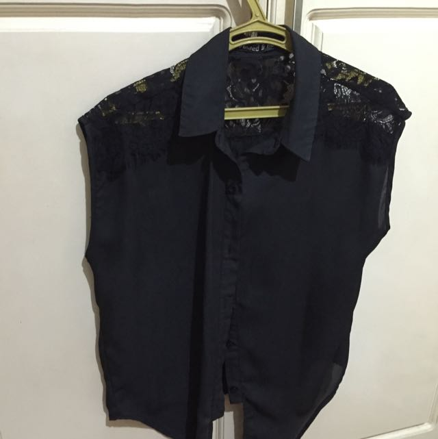 Folded And Hung Sleeveless Button Down Top
