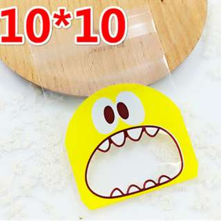 G17 - Self Adhesive Cookie Wrapper/Goodie Bag -  Monster (Yellow) 10cm x 10cm