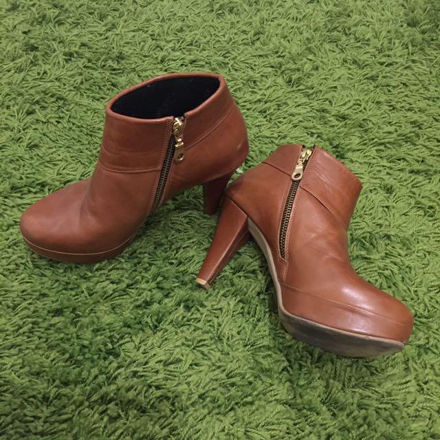 B. Unique Ankle Boots