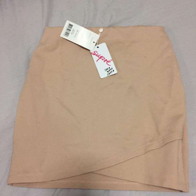 Supre Body on Tan Miniskirt XS