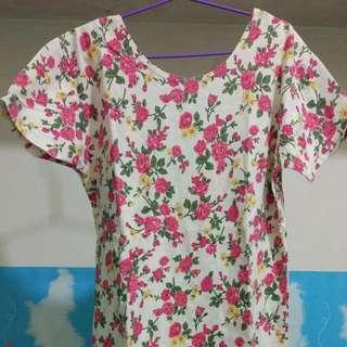 low-back floral blouse