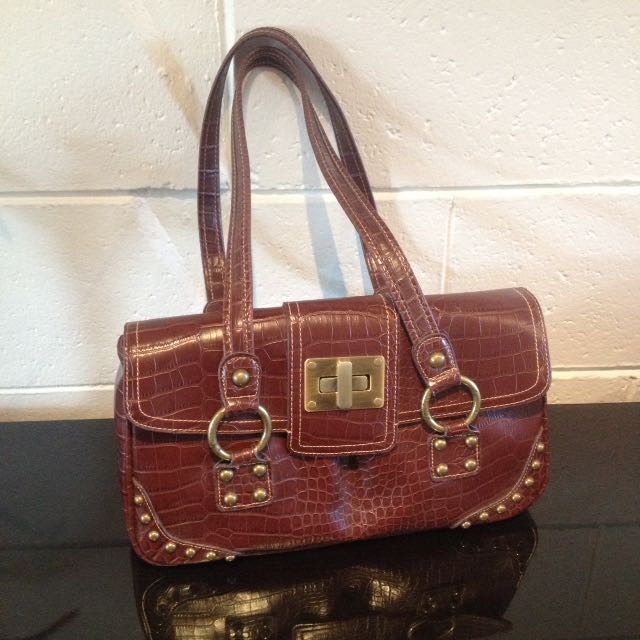 New/unused Rustic Red Handbag. 3 Sections + Pockets