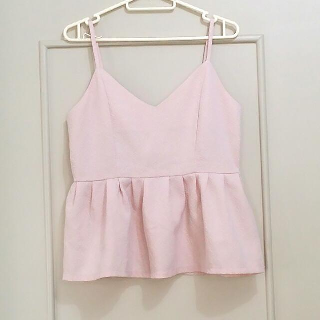 Pale pink peplum top