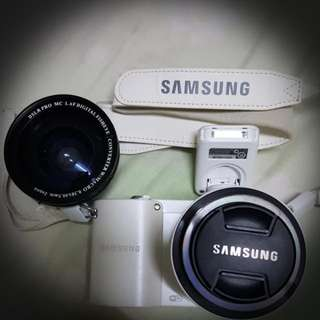 Samsung NX1000 20.3 Megapixel Mirrorless Camera (Body with Lens Kit) (20mm-50mm) - White (FREE Macro And Micro Lens)