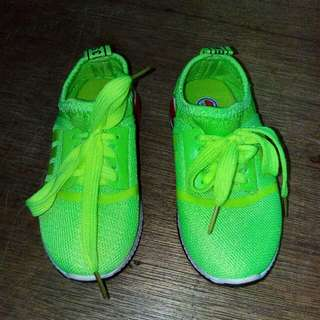 Neon green rubber shoes for kids