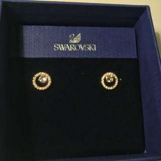 Pair of gold swarovski stud earrings