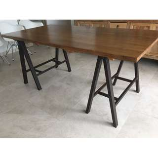 Gorgeous wooden table with a-frame steel legs.