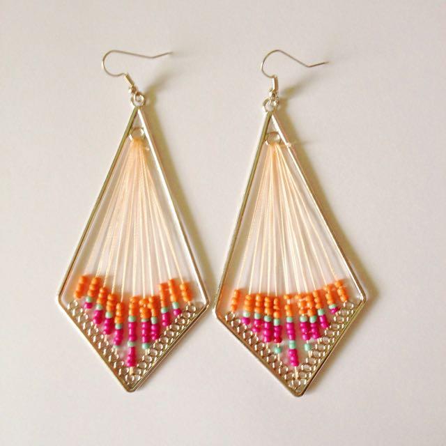 Handmade thread and bead earrings