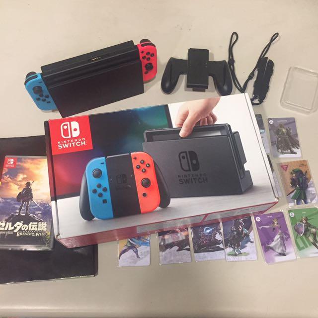 Nintendo Switch 任天堂遊戲主機 紅藍手把 + 薩爾達傳說荒野之息遊戲+ 繁中攻略本 + Amiibo 18張
