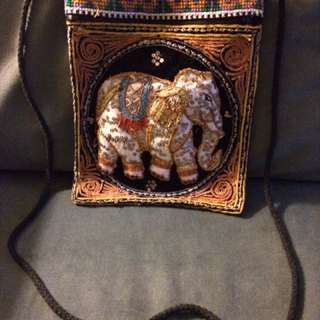 Brown and black knitted elephant cross body bag