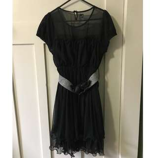 Black layered cocktail dress with silver belt
