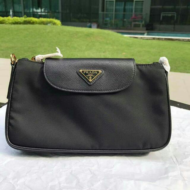 6dd789ecb2ba ... official prada bt0779 nylon tessuto saffiano wristlets luxury bags  wallets on carousell 60a0b 8b3e2