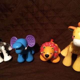 A Set Of Four Animal Safari Set.