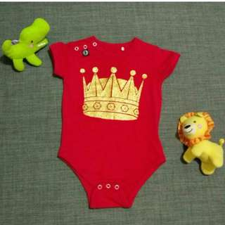 Red baby romper from Europe .