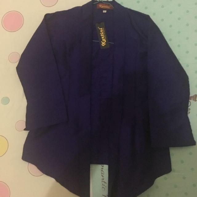 Kutu Baru dan Pleated Skirt
