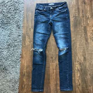 London Ripped-Knee Jeans