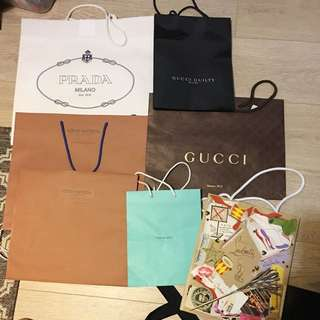 Prada Louis Vuitton Saint Laurent Christian Louboutin Gucci Tiffany & Co Carry Bags