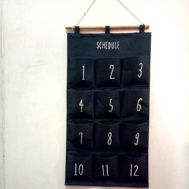 "Kantong Serba Guna ""Schedule""."