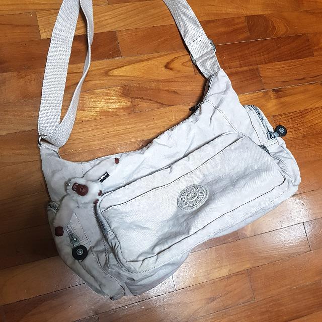 fb2ecc3c5e4 Kipling Off White Sling Bag, Luxury, Bags & Wallets on Carousell