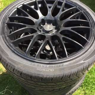 """4 Black 18"""" spider rims and tire. Universal rim 5 bolt taken off of a 2004 gti. (May need to replace two tires in the near future)"""