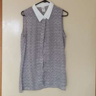 Greyish button-up top