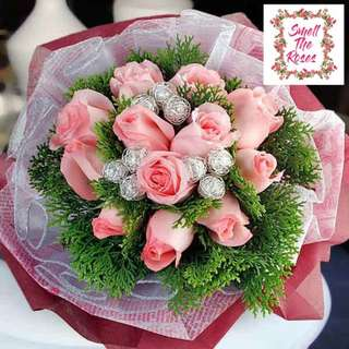 """You're gonna live forever in me"" - 12 Stalk Pink Roses & Christmas Leaf Designer Bouquet w/ FREE Surprise DELIVERY"