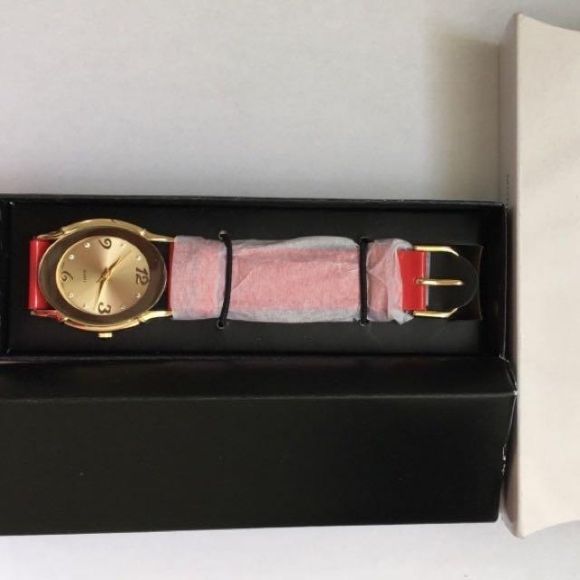AVON red N Gold Watch