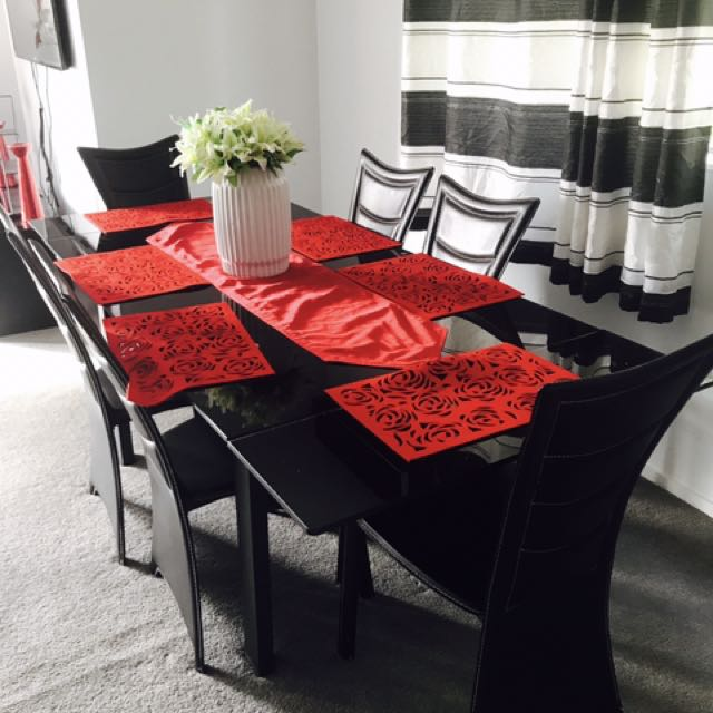 Tempered Glass Black Dining Table With Retractable Option