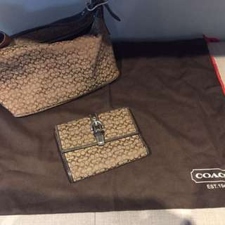 Brown Coach hand bag and wallet
