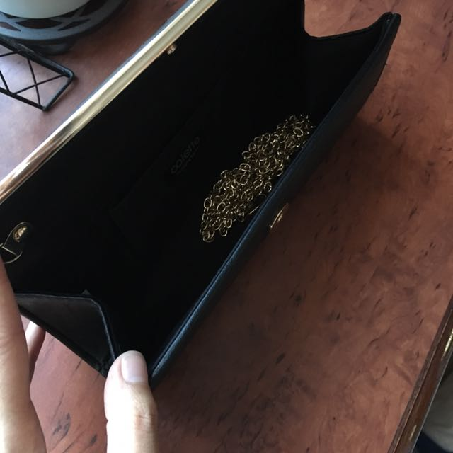 Barely Used Black And Gold Clutch Bag