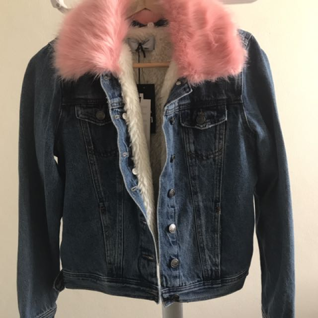 Denim jacket with pink faux fur collar
