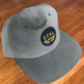 UNDER CONTROL olive cap