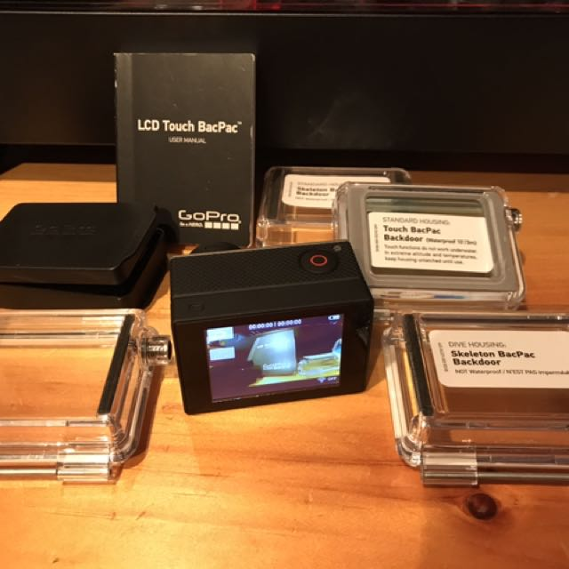 GoPro LCD Touch Bacpac with case, manual, 4 extended backdoors