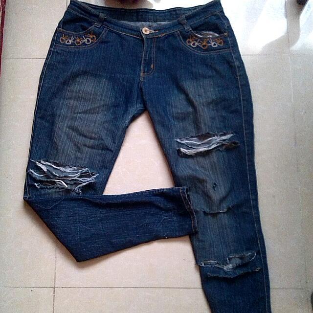 Ripped Flared Denim Pants