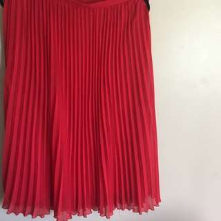 Pleated red chiffon skirt